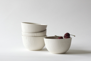 WantedDesign Holiday Market 2016 - Photo 1 of 6 - Woodgrain bowls, slipcast porcelain from hand-turned wood pieces, by Abigail Murray.