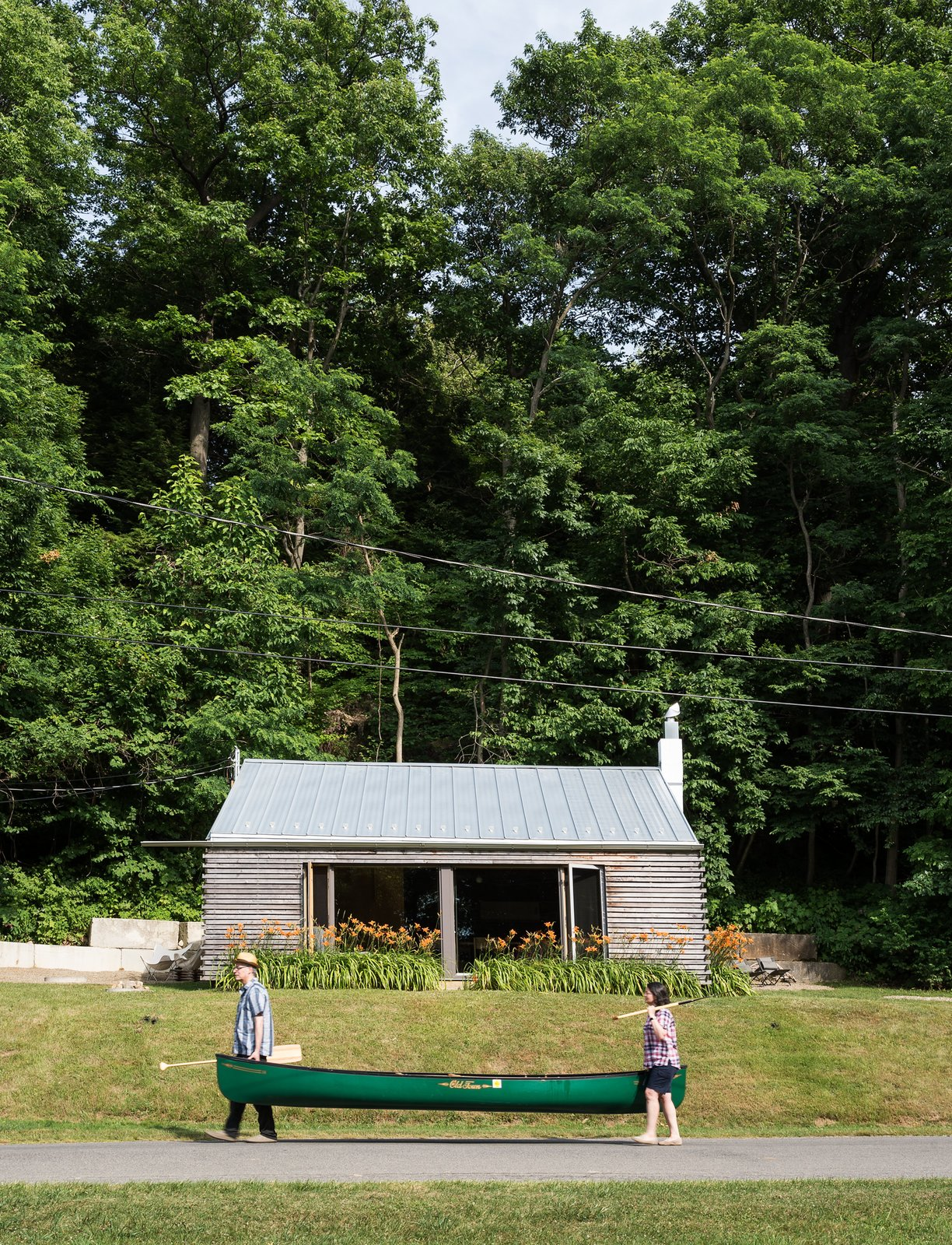 Architects Gerard Damiani and Debbie Battistone turned a budget buy into a condensed cabin getaway.  Photo 2 of 8 in Cottage Industrious