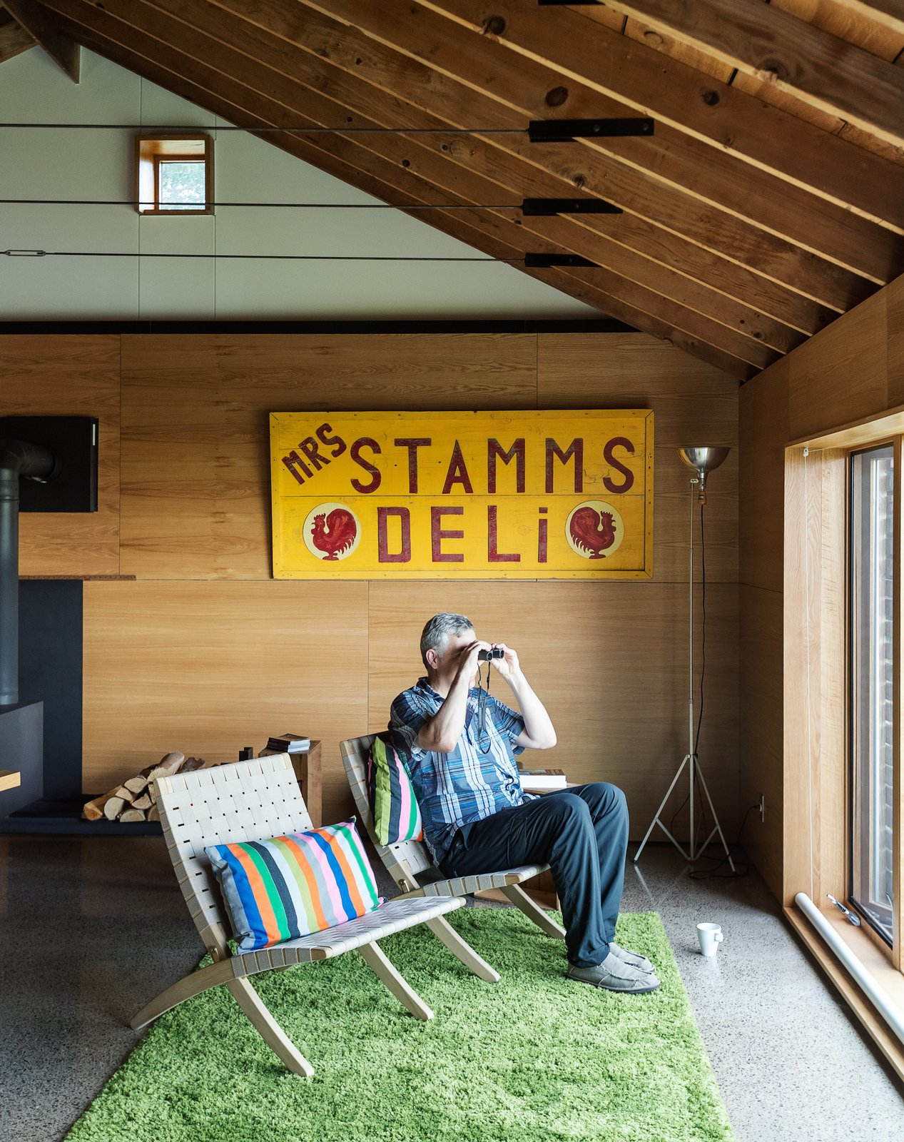 "At the lake house, the couple host guests, watch through binoculars as birds go by, sketch, grill, and just relax. ""We come up here primarily to get away,"" says Damiani."