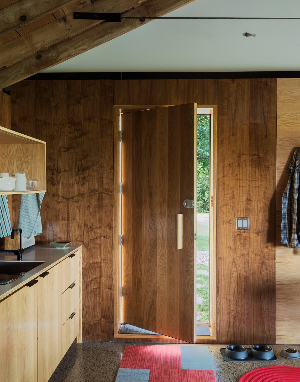 The curve of the door handle follows the golden ratio—the basis for Le Corbusier's Modulor system of proportions. Cottage Industrious - Photo 8 of 8