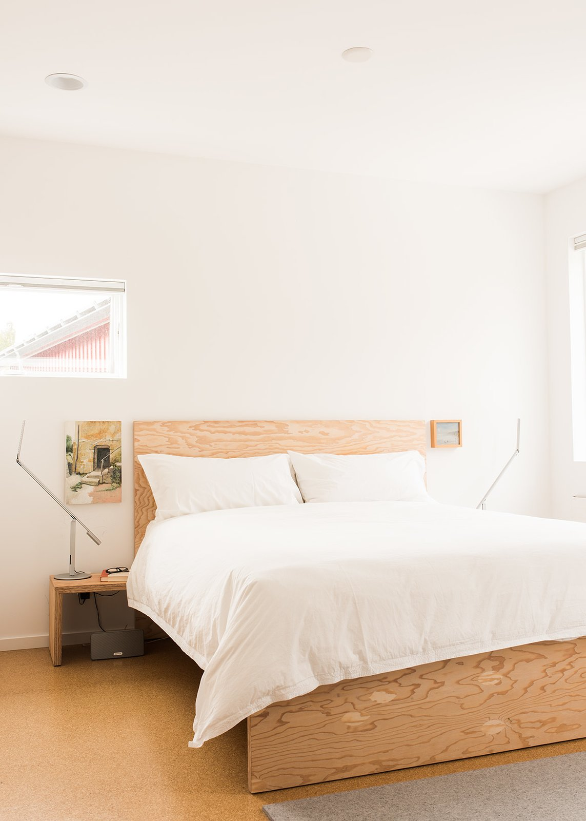 Davis used the same material to build furniture, including beds for his master bedroom. Tagged: Bedroom, Bed, Night Stands, Recessed Lighting, Light Hardwood Floor, Lamps, and Table Lighting.  Photo 7 of 15 in It Takes a Village
