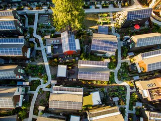 Rooftop Itek solar panels power the community—and are eligible for increased production incentives because they're made locally. Although the panels were optional, every Village resident chose <br>to install them.