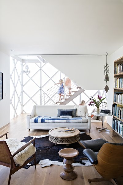 Vintage pieces furnish the library, which occupies the ground floor of the modular addition.