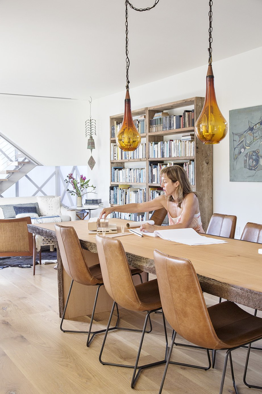 Siegal sits at a table made by Granada Millwork. The chairs are from West Elm and the pendants are from Patrick Braden.