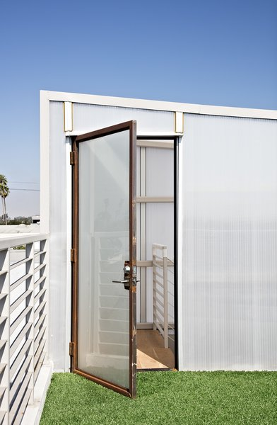 Carpeted with artificial turf salvaged from the Santa Monica Airport, the rooftop deck is a green getaway.