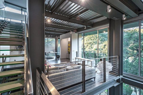 "Combining a prefab steel super-structure with concrete walls and insulated metal panels, Anthrazit House in Santa Barbara was designed by architects Pamela and Hector Magnus and built in collaboration with EcoSteel.""This wasn't a traditional Santa Barbara site with large acreage,"" Hector says. ""It was small and steep."" Expansive windows on the second floor face a park."