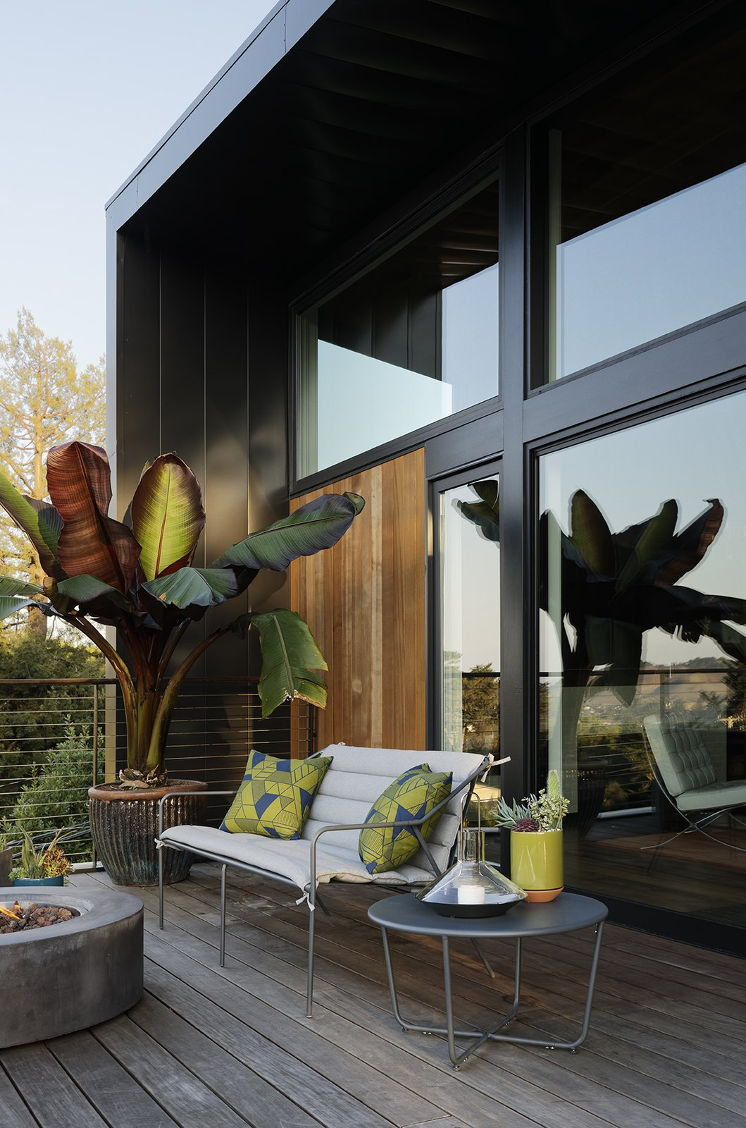 The barware, candle holders, dining set, lantern, terracotta planters, outdoor seating, and side table are all from the Modern by Dwell Magazine collection for Target. The fire pit is from Restoration Hardware. Tagged: Outdoor and Wood Patio, Porch, Deck.  Photo 4 of 15 in Moving Mountains