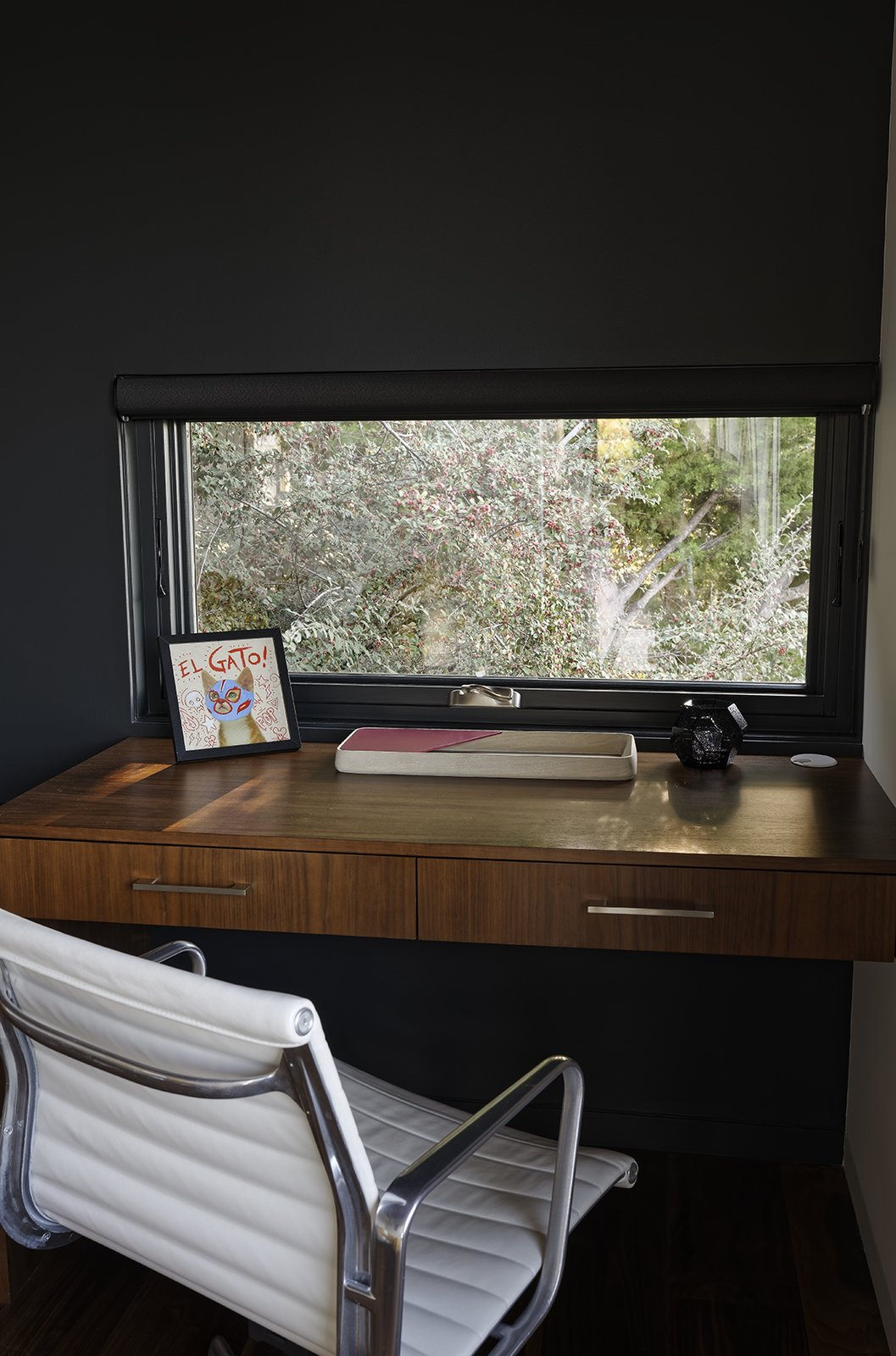 Chris designed a custom built-in desk in the den for Ellen, who often works from home. Tagged: Office, Chair, and Desk. Moving Mountains - Photo 7 of 15