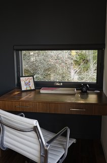 Moving Mountains - Photo 7 of 15 - Chris designed a custom built-in desk in the den for Ellen, who often works from home.