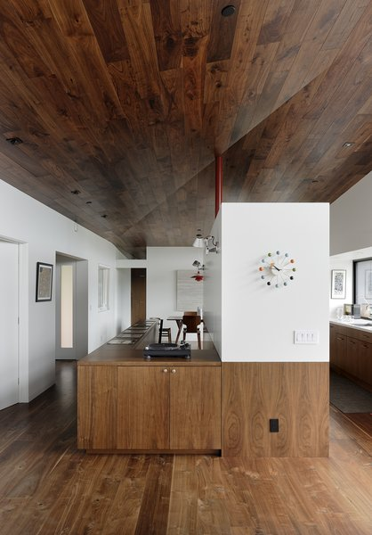 The adjacent volume houses the galley kitchen; the Ball clock is by George Nelson Associates.