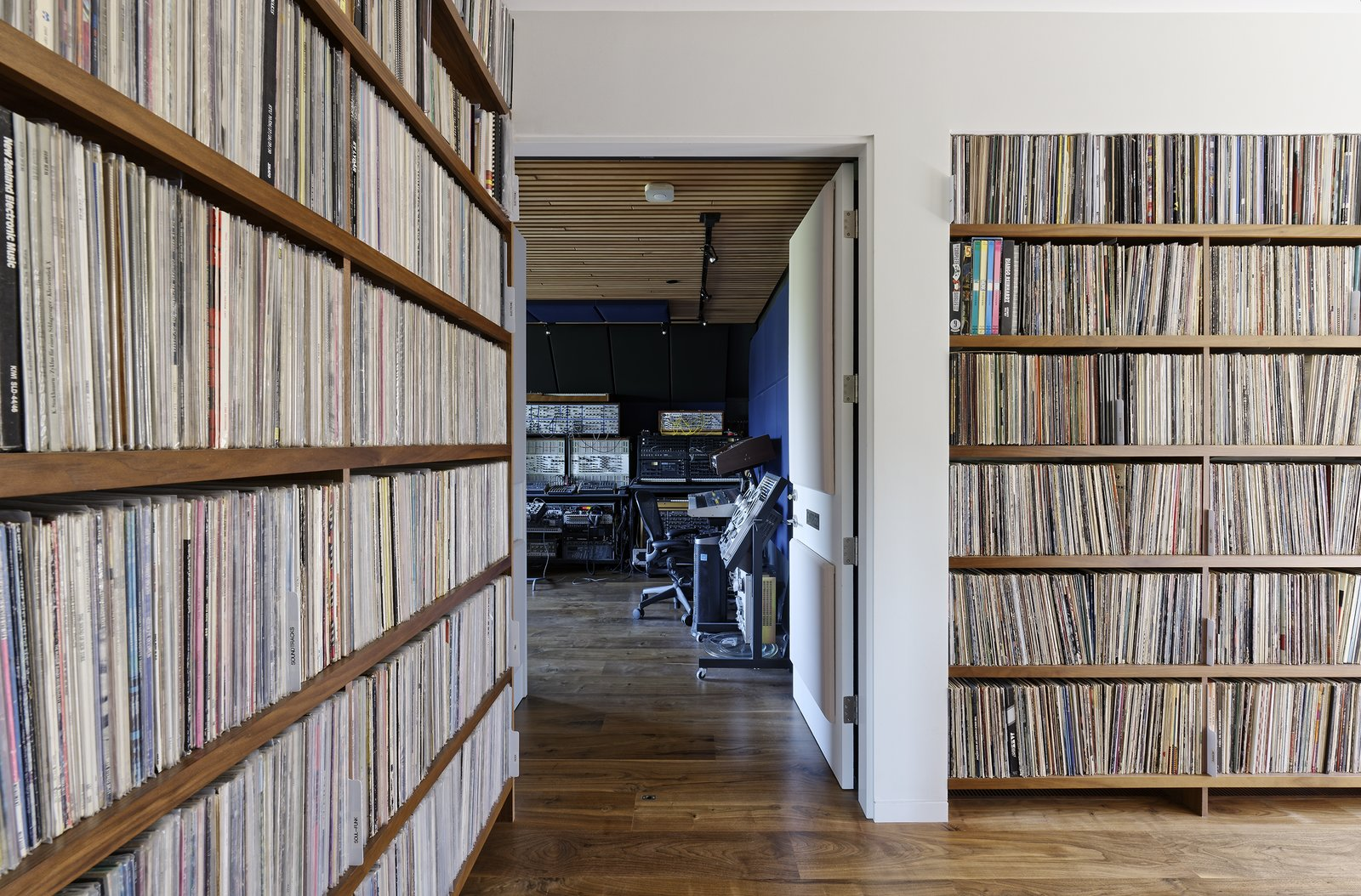 Downstairs are more shelves of records, the master and guest suites, and Jack's music studio. Tagged: Storage Room and Shelves Storage Type.  Photo 13 of 15 in Moving Mountains