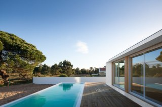 10 Sunny Poolside Prefabs - Photo 2 of 10 - MIMA Housing proposes a modular house that excels in simplicity, flexibility, and architectural quality. MIMA Essential bears a stunning bold simplicity and summarizes the whole philosophy in its essence.