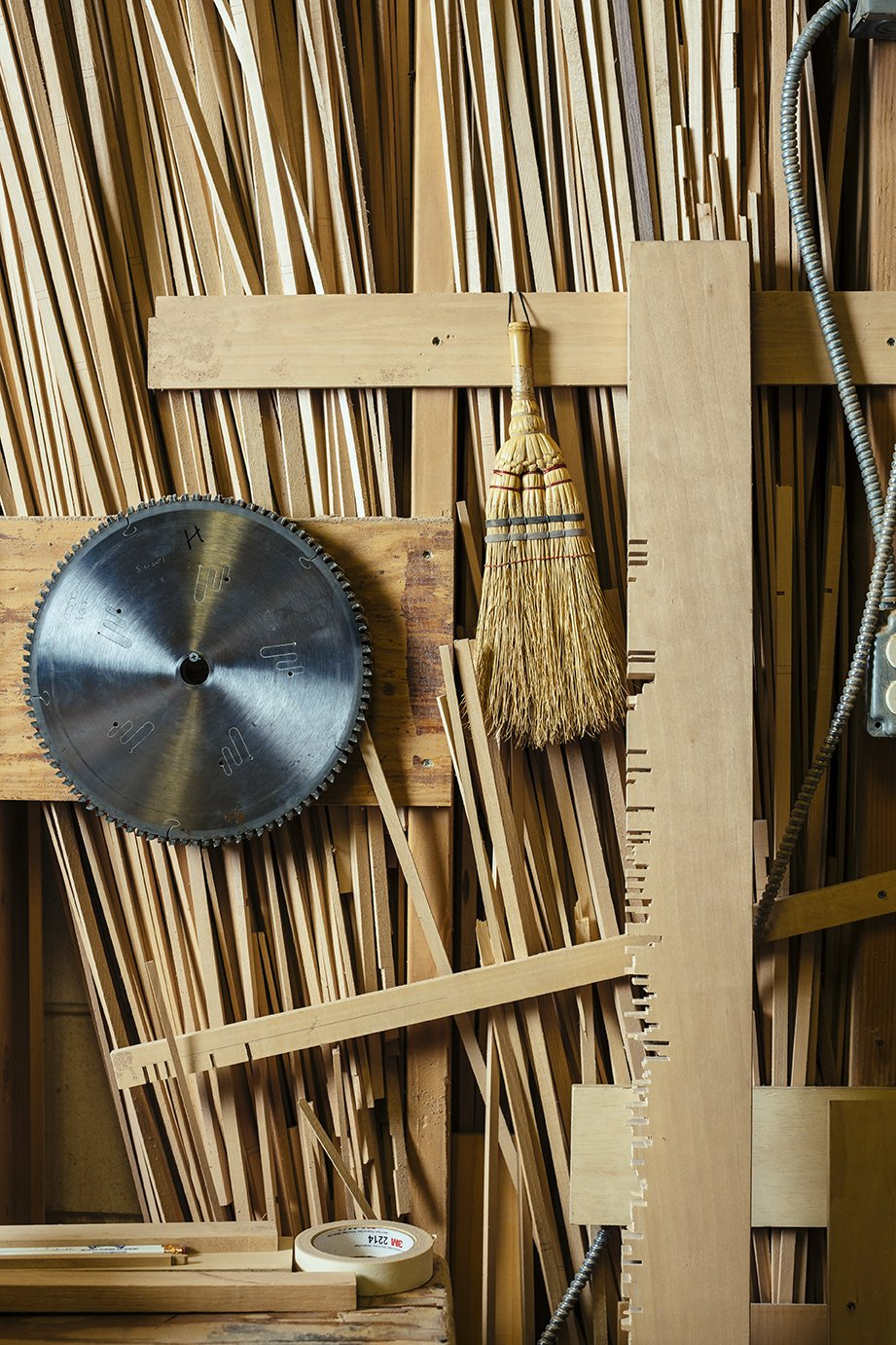 The saw blade, whisk broom, and aligning board that the craftsmen use to create screens hang on a shop wall.  Photo 4 of 7 in Undivided Attention