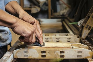 How to Shape a Shoji, Step by Step - Photo 5 of 8 - Held in place by a wood frame, whetstones with varying grades of fineness are used to sharpen the blade.