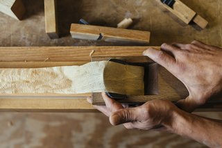 How to Shape a Shoji, Step by Step - Photo 6 of 8 - Hakamada carefully pulls a plane across the wood's surface. He will use only one stroke to make sure that the surface is even. It is never sanded.
