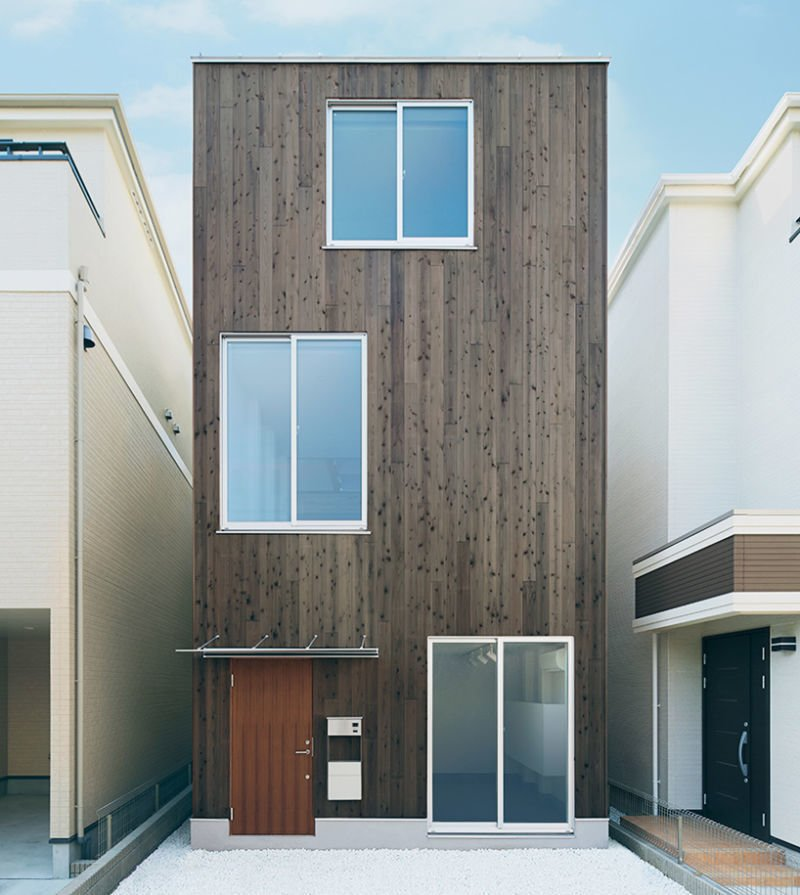 Project Name: Vertical House  Website: https://www.muji.com/jp/  Tagged: Exterior, Flat RoofLine, Wood Siding Material, Prefab Building Type, and House.  Photo 20 of 23 in 22 Modern Prefab Companies That Every Homebuyer Can Rely On