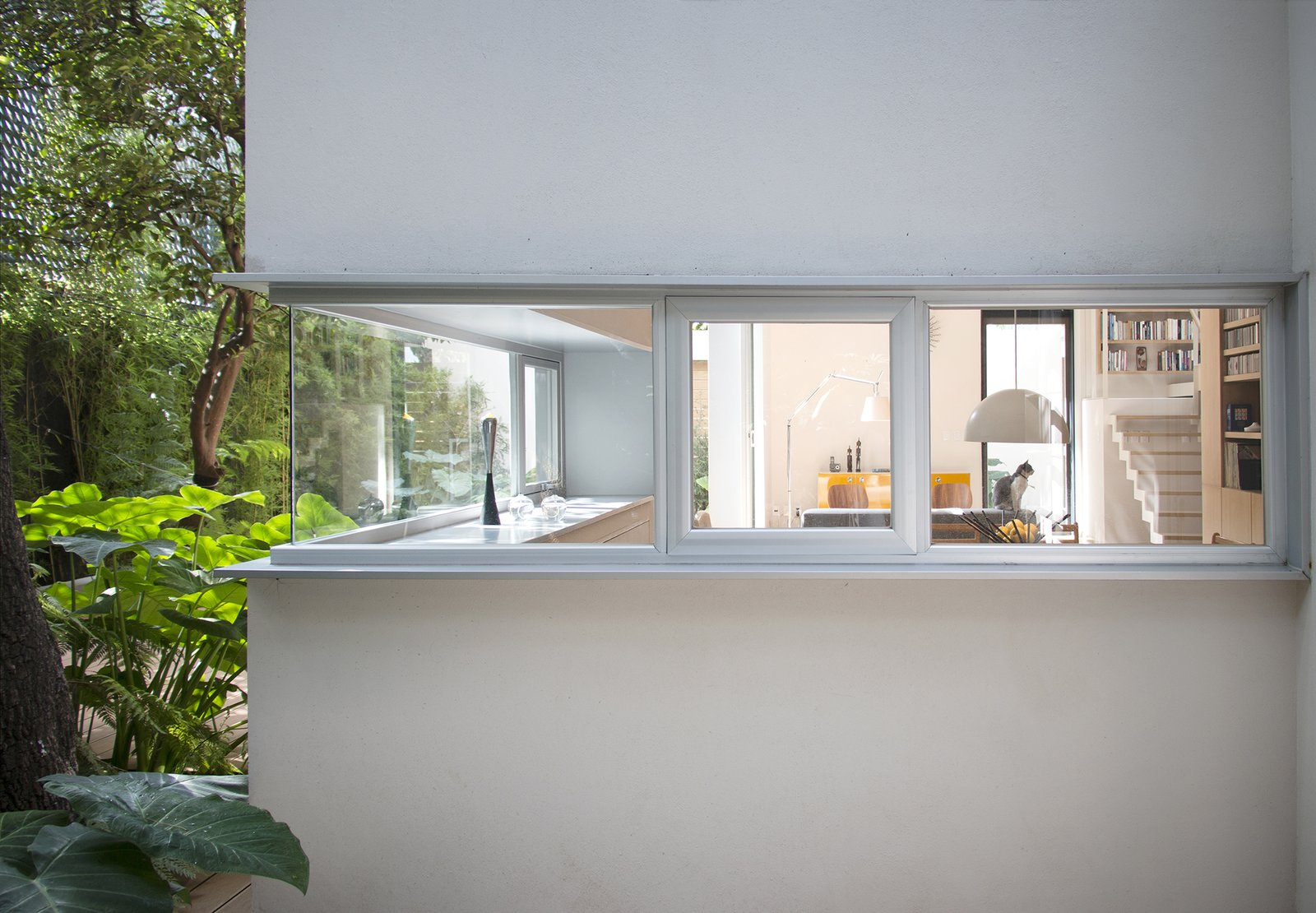 When Mexico City residents Nina Wanderstok and Raúl Cremoux were ready for a smaller house, they turned to their son, architect Paul Cremoux. The two-story structure he designed preserves open space on the property to support groundwater recharge in accordance with strict local zoning regulations. Retired Couple Build Modern in Mexico City - Photo 2 of 13