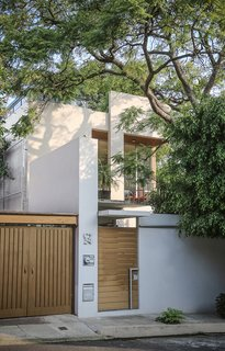 Retired Couple Build Modern in Mexico City - Photo 3 of 12 - In choosing materials, Paul evaluated their efficiency—and was surprised to find that local wasn't always best. In one nod to Mexican design, the structure is finished with fine plaster and white paint.