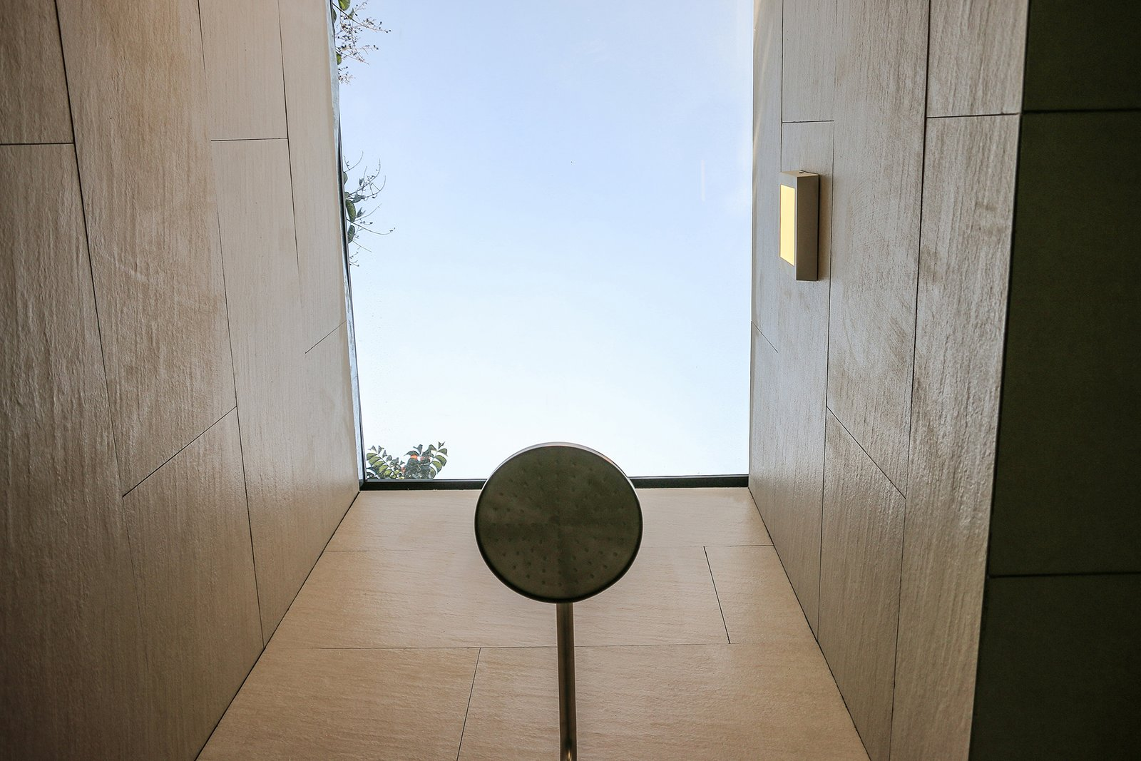 A custom aluminum-framed skylight with a 3M solar membrane floods the bathroom shower with light; the fixture is by Castel. Retired Couple Build Modern in Mexico City - Photo 7 of 13