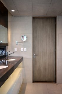 Retired Couple Build Modern in Mexico City - Photo 7 of 12 - The door is made of MDF panels attached to a wood frame and topped with an ash veneer. The tiles are from Spanish brand Vives.