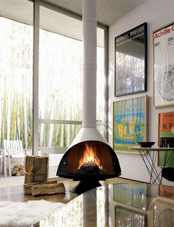 """10 Ways to Bring a Little """"Hygge"""" Into Your home - Photo 4 of 10 - The Malm Fireplace via DWR is available in black, white, or stainless-steel."""