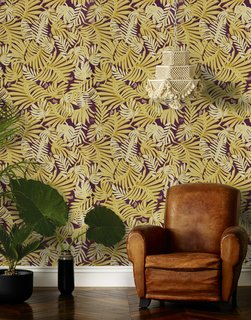 7 Wallpaper Designs That Will Instantly Revamp Your Space - Photo 2 of 14 - The deep golden yellow, cream, and beige leaves on this Aja (Aubergine) wallpaper—designed by Justina Blakeney for Hygge & West—gives this room a luxe, modern feel.