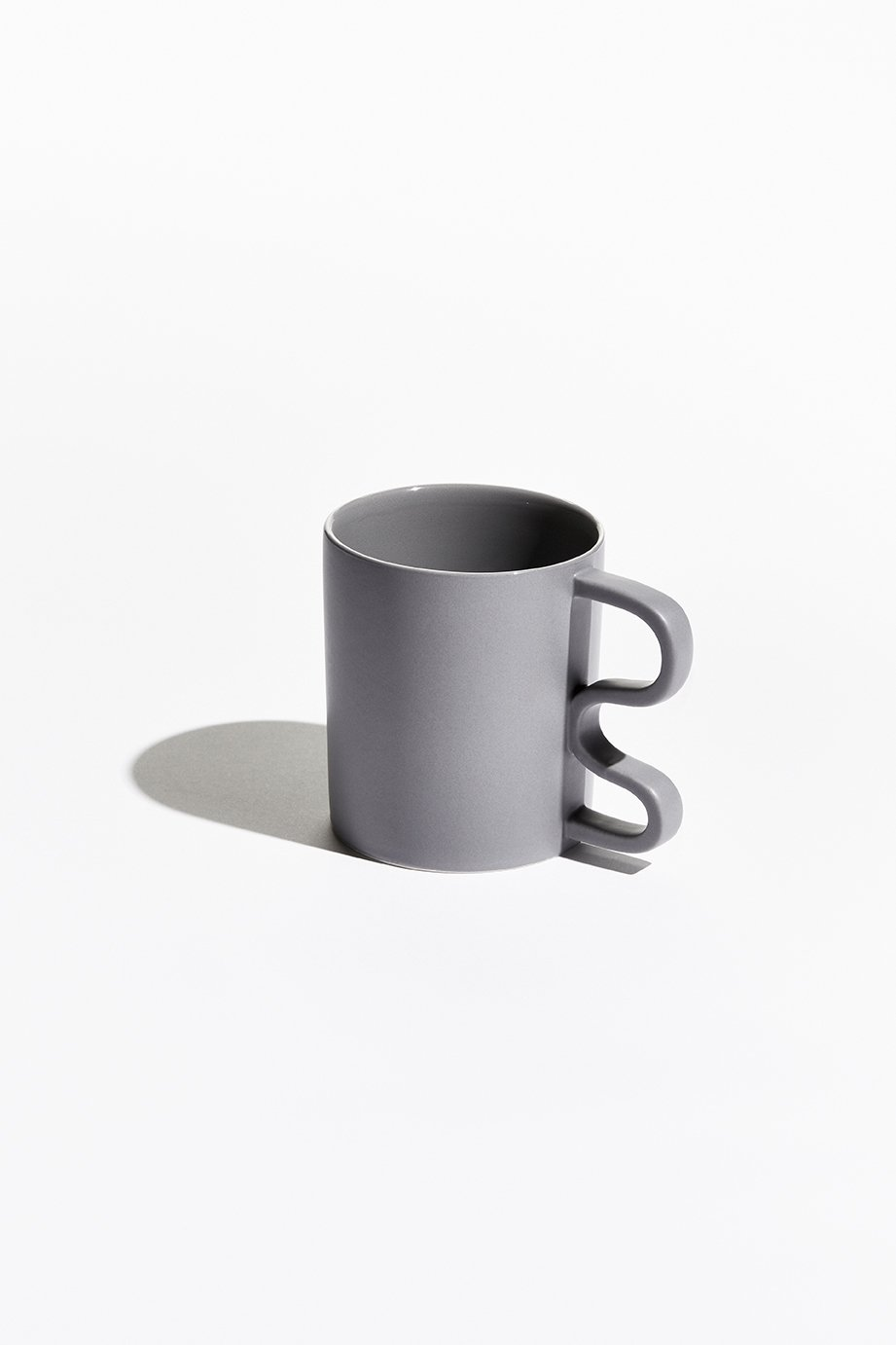 Rather than the conventional half circle, each mug is held by a sharp, squiggly, or abstract handle.  Photo 3 of 5 in Mean Mug