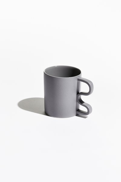 Rather than the conventional half circle, each mug is held by a sharp, squiggly, or abstract handle.
