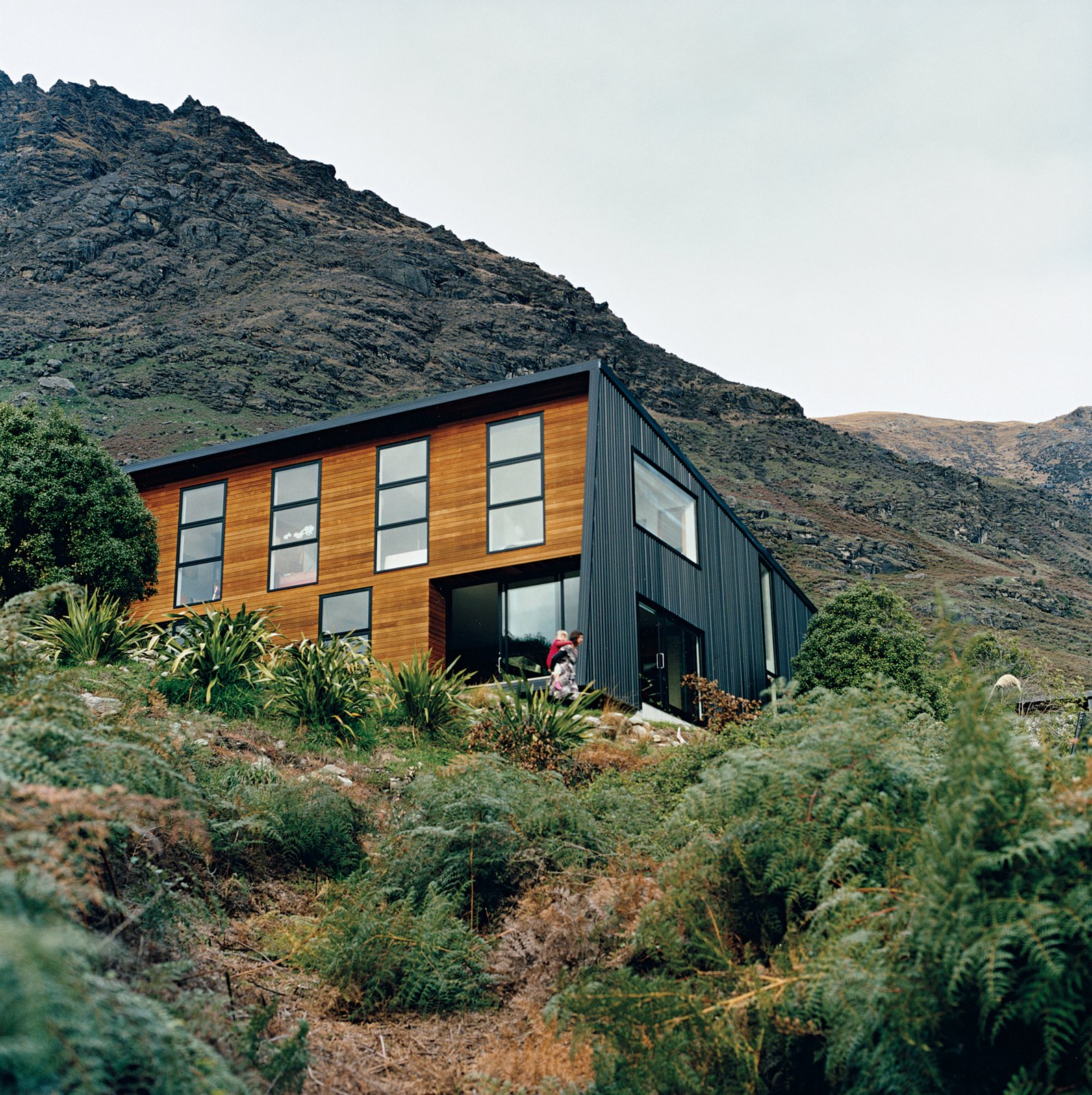 The location on the shores of a small bay means it is sheltered from cold southerly winds. The alpine location provided plenty of inspiration for landscaping, which Ritchie and Kerr elected to keep as minimal as possible, as if the home had landed on its site with as little disturbance or alteration as possible. Tagged: Exterior, House, Metal Roof Material, Wood Siding Material, and Metal Siding Material.  Drift Bay House by Dwell