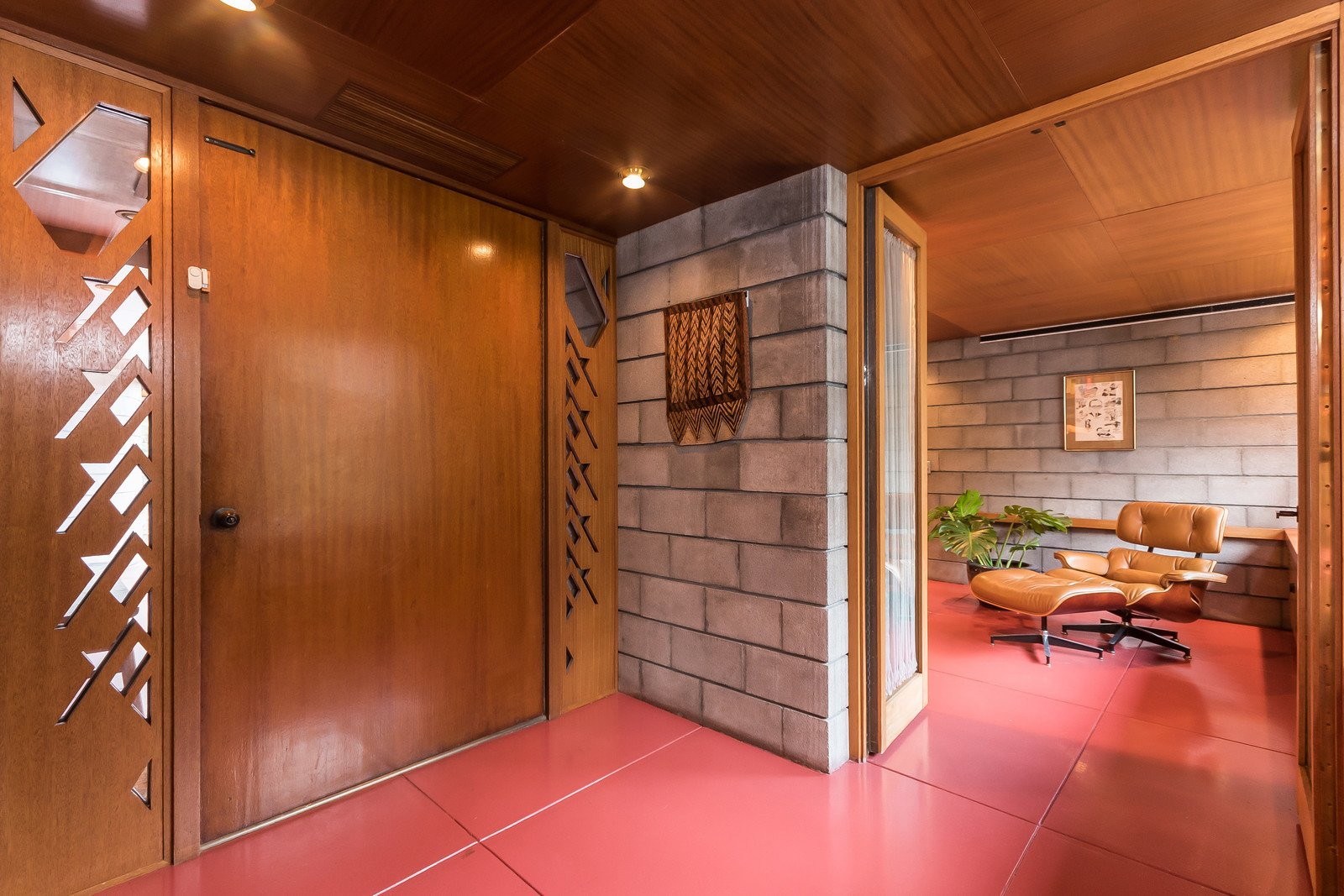 The interior of the home is almost completely lined with mahogany, along with sections of concrete blocks. Wright's design called for different cuts of wood to be placed together, which creates a rich layered effect.   Tirranna by Dwell