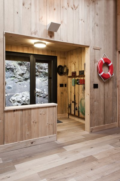 A mudroom has storage space for fishing gear, wet shoes, and jackets. Photo 8 of Casa Lago Todos los Santos modern home