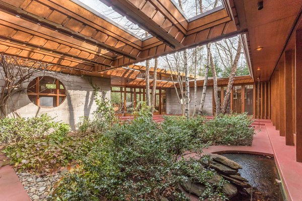 Since Wright was consistently focused on nature, he built an internal courtyard that creates a peaceful retreat in the middle of the structure. Photo 3 of Tirranna modern home