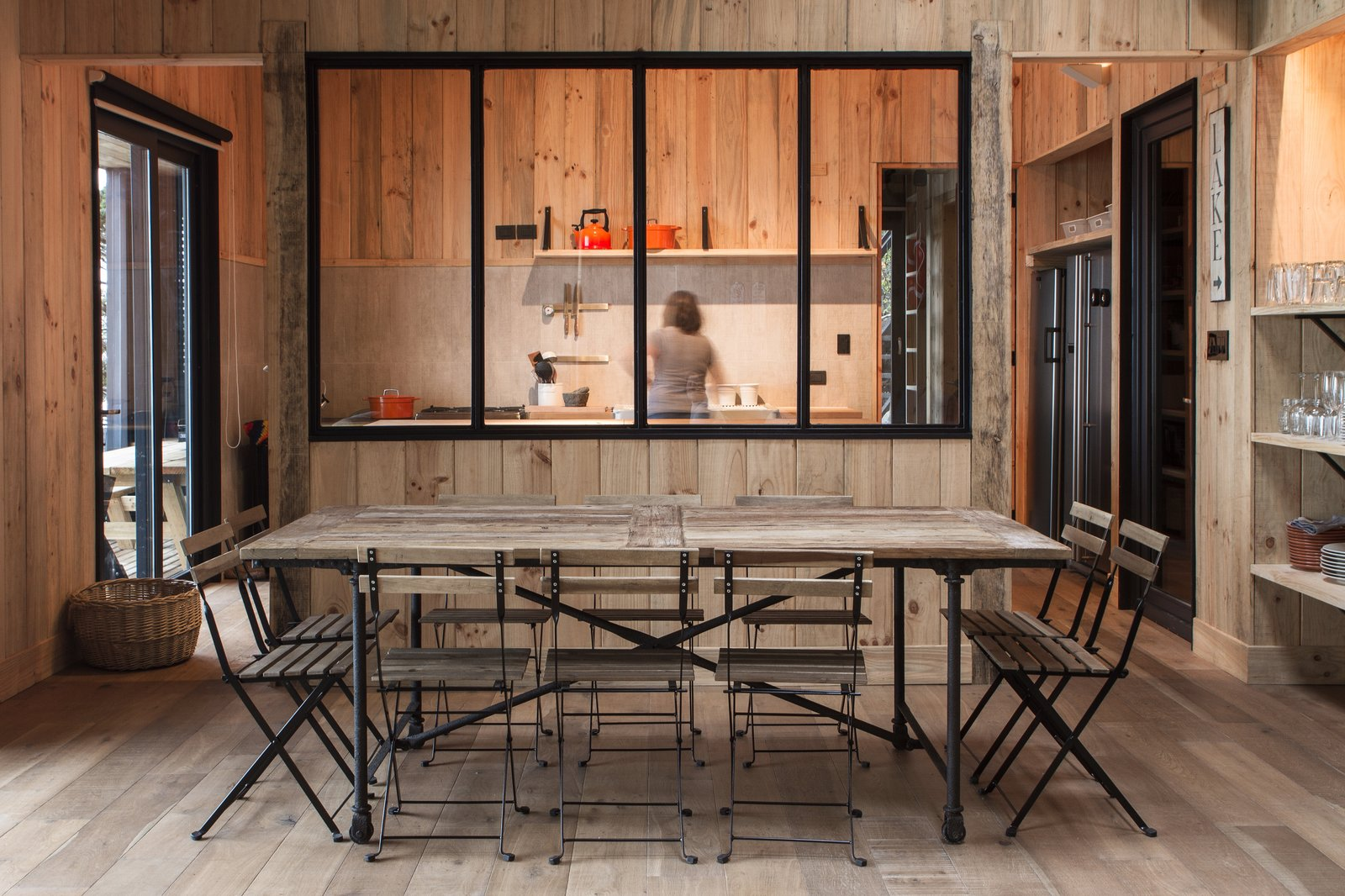 """Pine wood """"tejuelas,"""" or planks used for cladding and ceilings, wrap the entire interior in keeping with the Southern Chile regional vernacular. Its muted tones speak to the surrounding environment as well.  Casa Lago Todos los Santos by Dwell"""