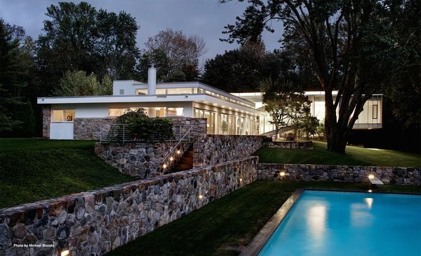 The Breuer property sits on three acres and includes a heated pool, pool house that was originally designed in 1981, sunning deck, and a Mori-designed wine cellar. The terrace features a waterfall and fern garden. Photo 3 of Marcel Breuer's New Canaan Home modern home