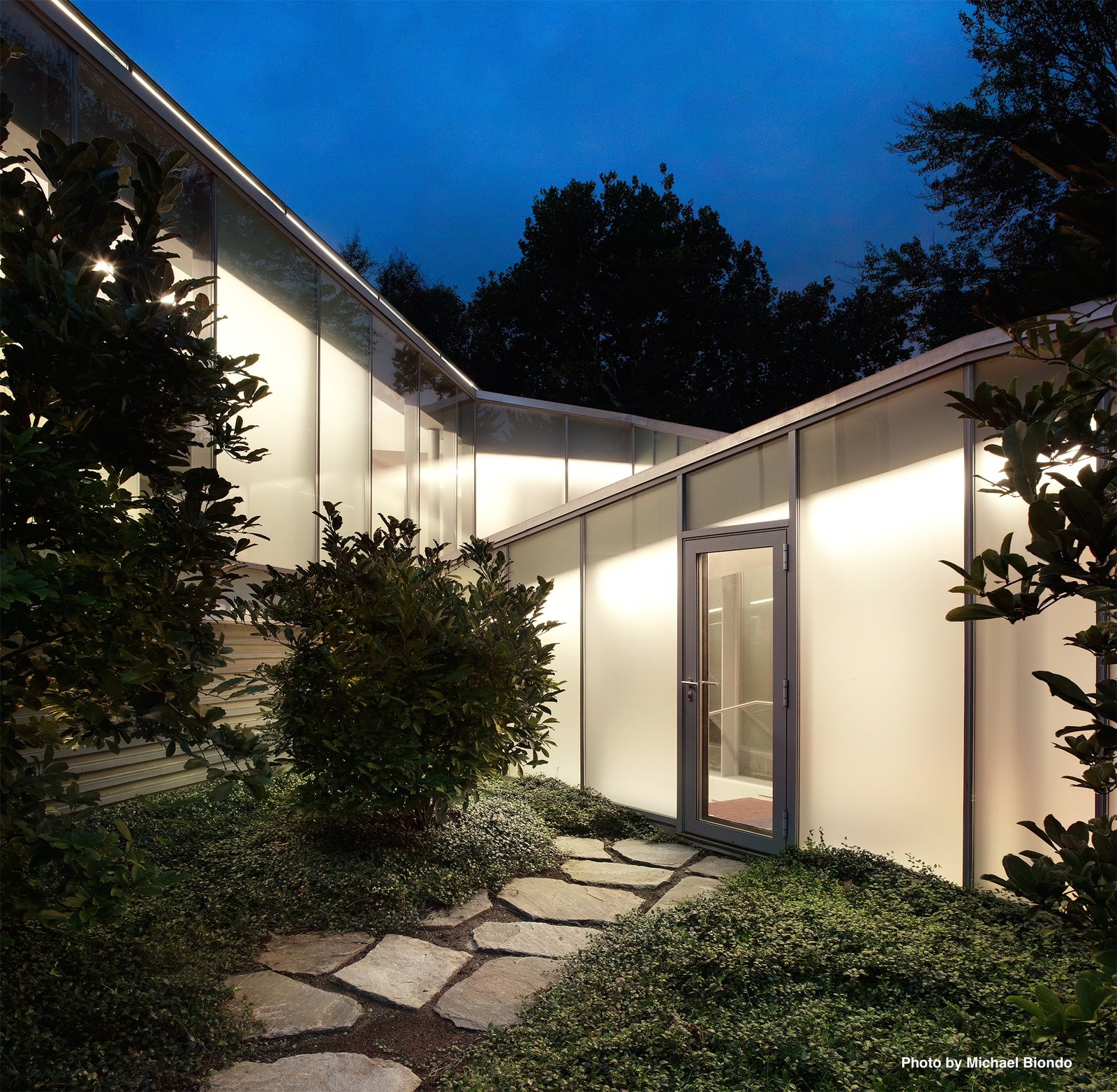 The original Breuer structure is connected to Mori's addition by a triangulated glass corridor that includes a graduated staircase.  Marcel Breuer's New Canaan Home by Dwell