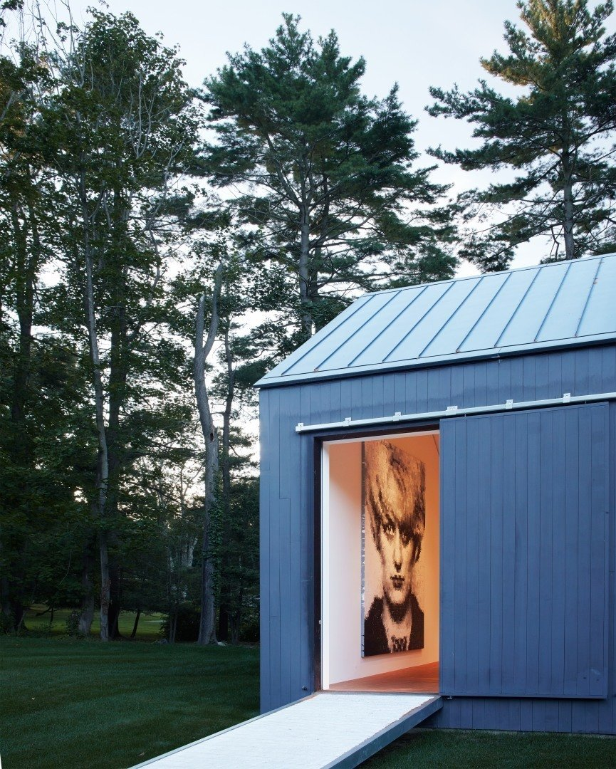 Take a peek into the edge of the 19th-century barn that Ferris transformed into a gallery. The traditional barn structure was retained while the interior was turned into a minimal and open canvas for the current homeowner's art collection. It'll be interesting to see how the next owner utilizes the space.