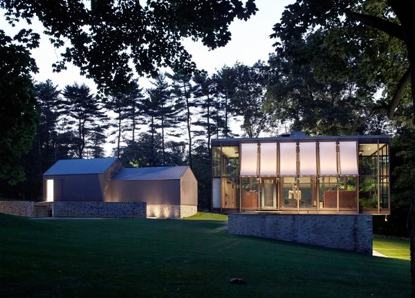 Built in 1953, the Wiley House is made up of a single glass-and-wood rectangular pavilion that's perched on top of a rectangular box made of stone and concrete. Johnson chose the six-acre plot of land himself and was particularly fond of the natural slopes of the site, which is surrounded by hickory trees.   Photo  of Wiley House modern home