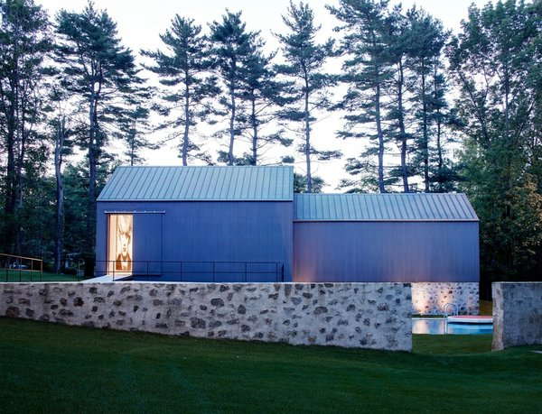 The stone treatment works as a connecting factor throughout the property and preserves a building practice that was common at the time.  Photo 4 of Wiley House modern home