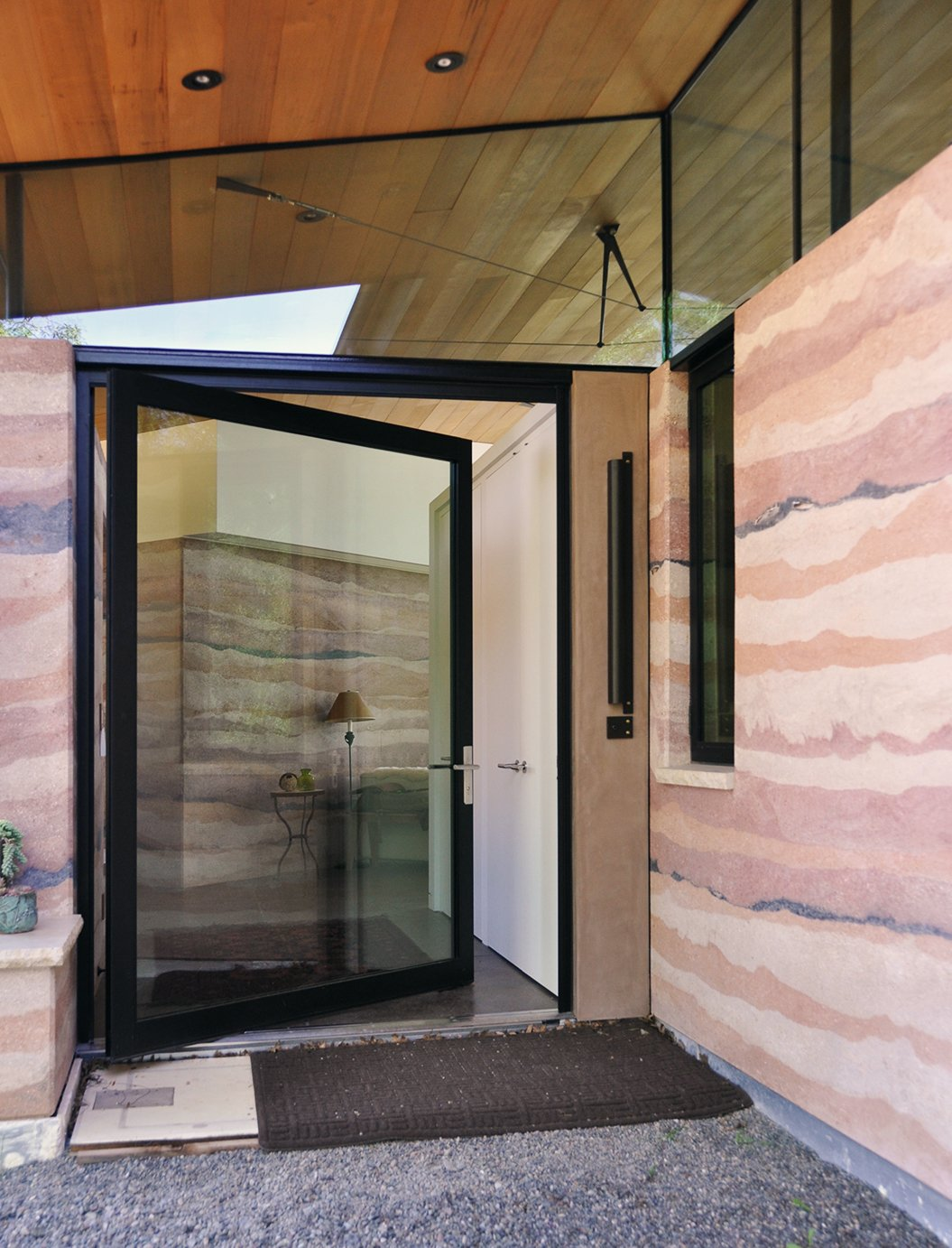 Contractor John Richards built the earthen facade to take on the appearance of sedimentary rock, referencing drawings the residents made to show the range and depth of colors they desired. Geological Formation - Photo 3 of 8