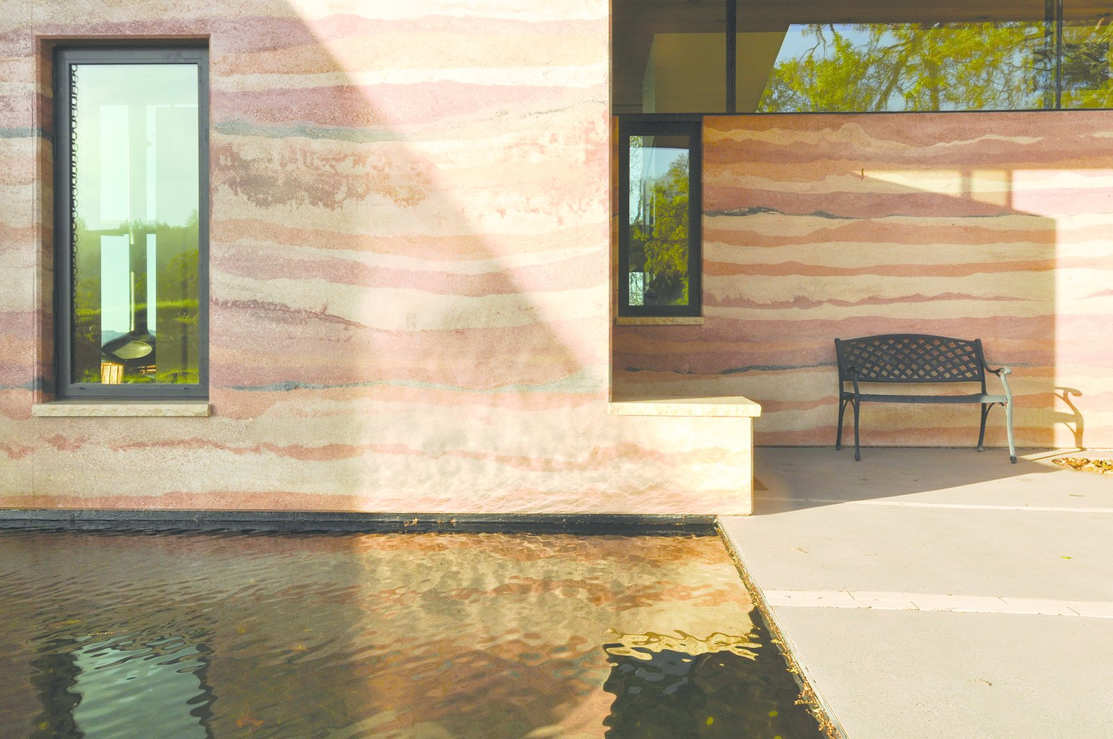 A 70-square-foot reflecting pool greets visitors as they approach the home's elemental north entrance. Tagged: Outdoor, Back Yard, Front Yard, Side Yard, and Standard Construction Pools, Tubs, Shower.  Photo 5 of 8 in Geological Formation