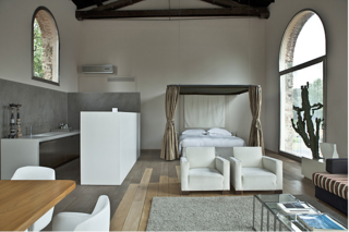 10 Rentable Homes in the World's Best Wine Regions - Photo 5 of 10 - Chic nomads in search of a vacation home for rent in Italy will love these stylish lofts near the center of Florence. Part of a small hotel-like cluster of apartments converted from an old factory, they offer a truly unique experience for travelers.