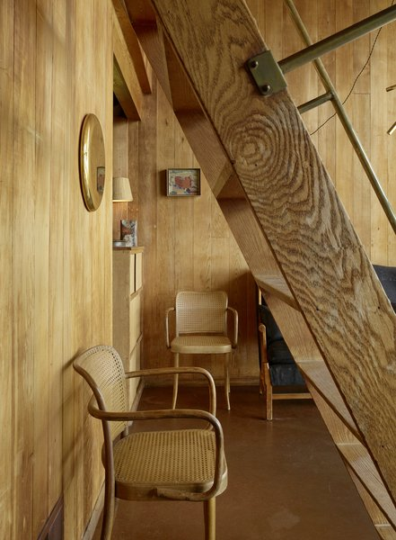 A repurposed WWII ladder is turned into a stairway that leads to the loft.