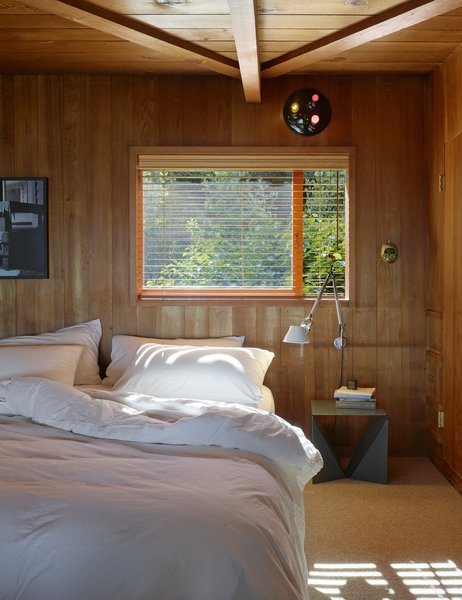 Another bedroom is left simple to let the wood do the talking.