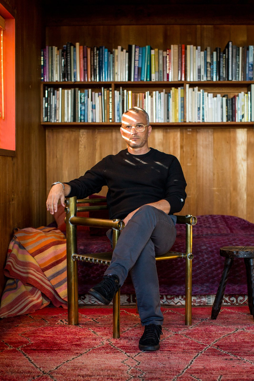 Charles de Lisle is shown here sitting in his Marin, California home. As a designer of furniture, lighting and objects, de Lisle mixes unexpected materials and mediums to create useful objects that are full of texture and character. Creatives of the Bay Area Series: Charles de Lisle - Photo 1 of 12