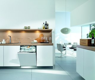 5 Modern Dishwashers - Photo 2 of 5 - This white Miele model is designed to blend seamlessly into white kitchen cabinetry. The brand's patented Knock2Open technology does away with handles, allowing for a completely flush facade that users can tap twice to gain access. It comes equipped with an adjustable cutlery tray and interior LED lights, and it automatically recognizes how full the load is and adjusts energy and water use accordingly. It's also one of the quietest dishwashers available at 38 decibels.
