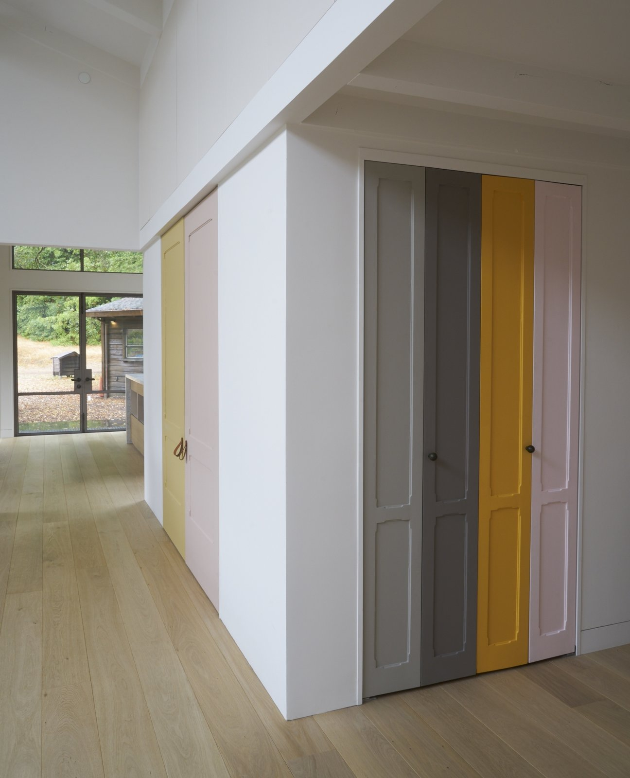"Playful panels of color on closet doors and the stair risers break up the white walls. The homeowner explains, ""I took as inspiration Imi Knoebel, whose work I had seen at the Dia Beacon, and who works with large shapes of color placed in relationship to one another.""   Beetlebung by Dwell"