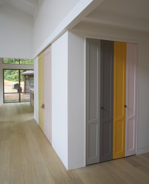 "Playful panels of color on closet doors and the stair risers break up the white walls. The homeowner explains, ""I took as inspiration Imi Knoebel, whose work I had seen at the Dia Beacon, and who works with large shapes of color placed in relationship to one another.""  Photo 2 of Beetlebung modern home"