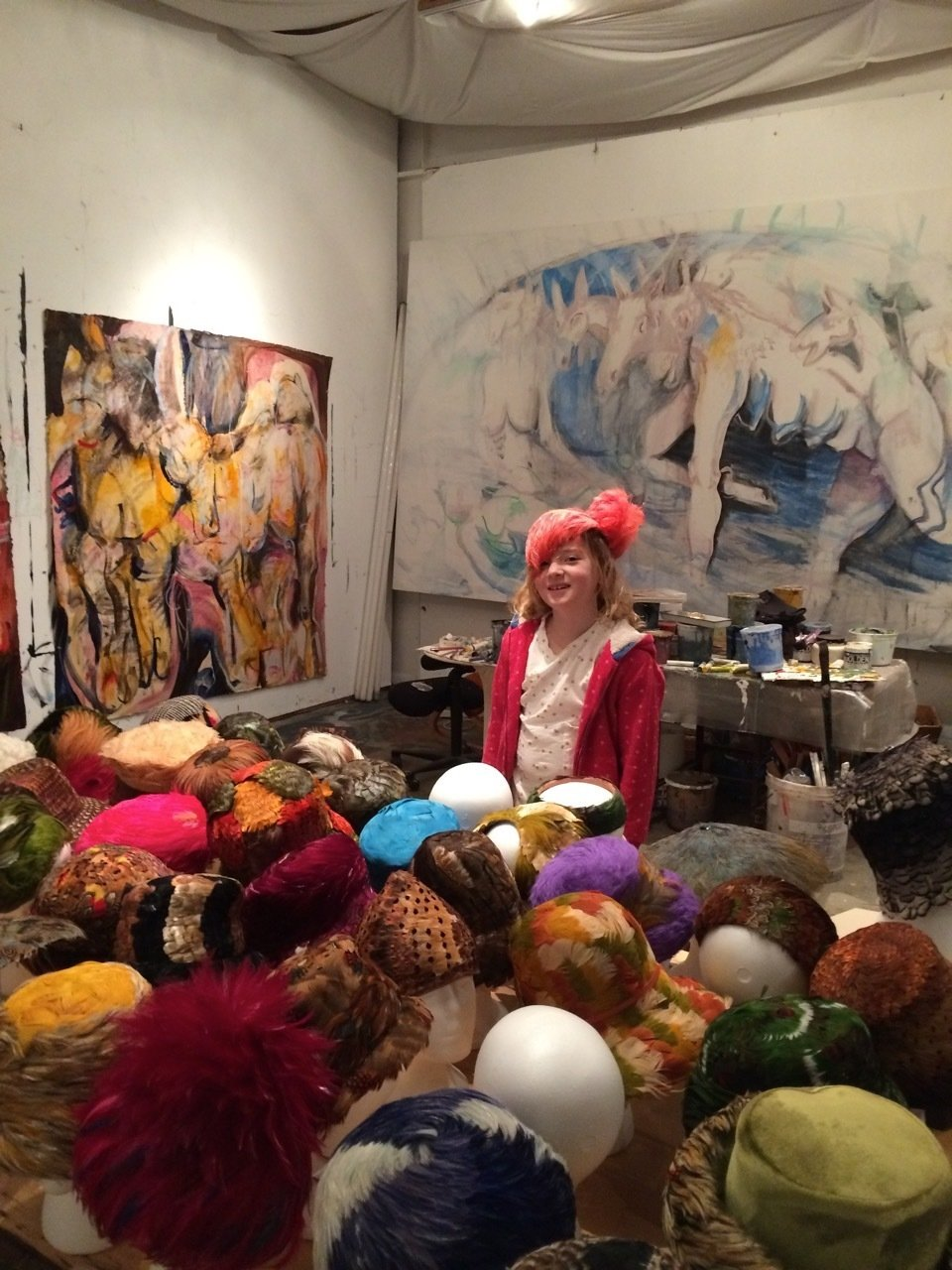 painting vintage Dior hat collection in Madeleine's studio. mixed. visitor. whole range of makers. 50s to 70s.