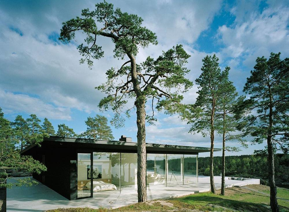 The matte black exterior and floor-to-ceiling glass of Villa Överby sit flush on limestone slabs.  Photo 2 of 16 in 10 Modern Homes That Made a Star Appearance in Films