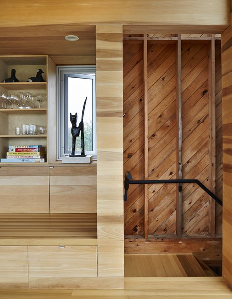 "Stairwells and service areas utilize knotted planks. ""It's akin to stepping offstage into the wings,"" resident Rhonda Rubinstein says of the transition. Photo 6 of Sliding House modern home"